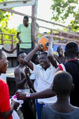 Haitian Soccer on a Sunday (Jesonis Photography_On/Off (super busy)) Tags: soccor haiti sports caribbean gameball winner joy orange team smile