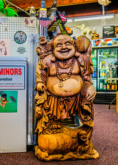 At our local liquor store--DSC3872--Port Orford, OR (Lance & Cromwell back from a Road Trip) Tags: finch budda wood statue