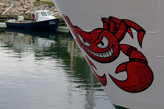 A crab painted on the bow of a fishing boat in Sainte-Thrse-de-Gasp, Qubec (Ullysses) Tags: crab crabbe saintethrsedegasp qubec canada bow fishingboat fishingvessel bateaudepeche gaspesie summer t havre harbor