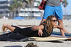 Vanessa White of The Saturdays takes surfing lessons on Venice Beach Los Angeles, California