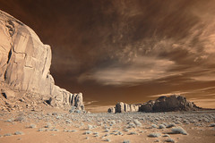 Monumental Infrared (Bill Gracey) Tags: road travel vacation arizona tourism nature composition rocks surreal infrared dirtroad monuments iconic formations rockformations scenry buttes monumentvalleytribalpark theoldwest