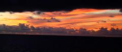 la virgen planchando (Juni Cheesecake) Tags: sunset sea sky color colour sol clouds island atardecer la mar fishing lanzarote cielo puesta pesca isla famara graciosa