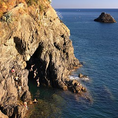 Samantha jumps, jumps and jumps (Bn) Tags: world travel blue sea summer cliff holiday heritage water colors kids swimming children fun island happy concentration site nationalpark cool intense jump jumping topf50 holidays rocks locals liguria joy dramatic rocky diving highlights cliffs unesco adventure edge terre multiple shooting cave dare traveling joyful popular monterosso idyllic adrenaline jumps thrill cinque exciting adriatic mediterraneansea continuous timing 50faves springboards adreline crystalclearblue
