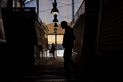 Sun and shadow and old man silhouette and other silhouette in the background (javiermartinphoto) Tags: barcelona street light people urban color digital shadows streetphotography streetphoto boqueria sunandshadow streettogs javiermartinphotocom peoplewhoneveryawn