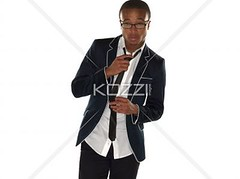 portrait of a businessman adjusting tie (peoplereba2012) Tags: man black guy businessman standing holding formal lifestyle tie professional business suit indoors attitude whitebackground formalwear teenager studioshot adjusting pulling confident oneperson photograhy frontview formalattire welldressed ortrait teenageboy colorimage lookingatcamera 1617years fullsuit threequarterlength oneboyonly shirtand