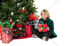 smiling boy with his christmas present, (peeps2012ilay) Tags: christmas boy portrait cute male smiling festival season photography holding december sitting joy fulllength adorable happiness wrapped christmastree celebration indoors event whitebackground gift christmasdecorations blonde surprise innocence ribbon studioshot cheerful excitement casualwear oneperson caucasian lifestyles christmasgift wrappingpaper individuality giftbox toothysmile exited casualclothing colorimage lookingatcamera childrenonly 1213years expressingpositivity legscrossedatankle publiccelebratoryevent preadolescentage