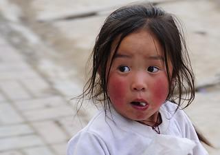 Small Tibetan girl does not often see tourists, Tibet 2012