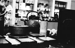 Tea paraphernalia (anmyk) Tags: blackandwhite bw film 35mm iron dof minolta tea kodak tmax grain highcontrast bamboo depthoffield kettle cast 400 teapot accessories grainy pushed expired 3200 maxxum infuser paraphernalia 300si 3stops teatools 400pushedto3200 anomyk