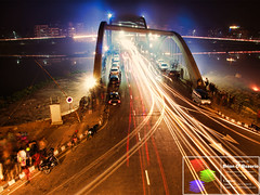 As The Rush Comes (Brian D' Rozario) Tags: city longexposure bridge urban reflection night reflections dark landscape flow nightly glow cityscape darkness traffic doubleexposure smoke crowd citylife rush smokey glowing dhaka bangladesh fragment lightstreak rushing crowdy d7k nikond7000 hatirjheel briandrozario brian19869 hatirjhil