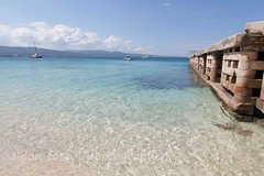 Jamaica-MoBay-Beach-5713 (alison.toon) Tags: blue sea vacation sky copyright holiday tourism beach water pier seaside photographer turquoise restful peaceful tranquility jamaica caribbean groyne tranquil montegobay breakwater doctorscove alisontoon