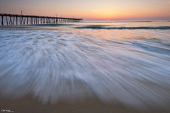 incoming ([Chris Tennant]) Tags: ocean sea sun beach nature sunrise dawn coast pier nc sand waves northcarolina shore outerbanks obx 14mm 5dmkii christennantphotography