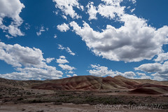 Painted Hills and Clouds (Edward Mitchell) Tags: fossil fossils johnday oregon paintedhills geology clouds colors hills nationalmonument lumixgh4 gh4 panasonic olympus918mm