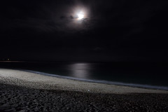 Nightfire (Sherbaz Hashmi) Tags: bali beach night dark moon flare clouds reflection