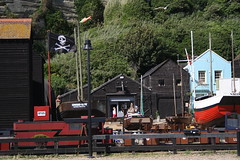 Skull and Crossbones (My photos live here) Tags: flag skull and crossbones pirate boat buildings beach fishermen hastings east sussex england seaside holiday resort canon eos 1000d