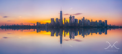 City Skyline Sunrise Panorama Reflections (Mike Ver Sprill - Milky Way Mike) Tags: manhattan freedom tower sunrise sun hazy haze reflections water hudson river long exposure cityscape landscape island mike ver sprill michael versprill milky way explore jersey city nj ny new york fine art photography large format printing america beautiful amazing surreal rocks skyline sunset outdoor dusk sky serene architecture