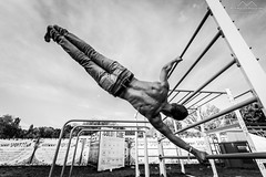 Stretched  Out (Mark Horvath) Tags: bw budapest eu europe hajogyari hungary obuda sziget sziget2016 szigetfestival ablebodied athlete back barefoot blackwhite blackandwhite bnw boy climbing dark daylight desaturated diagonal festival gymnast halfnaked human islandoffreedom jeans male man monochrome muscle muscular people sexy sky strong summer szitizen wide wideangle young