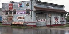 Building  in Ravenna  Kentucky (A  Train) Tags: kentucky ravennakentucky advertising signs nikon texaco cocacola hoosiertire