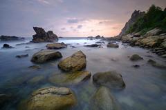 Isolated (nGkU Li) Tags: ngkuli nature indonesia seascape sunset sea xpro2 fujifilm flickrtravelaward water outdoor yogyakarta watulumbung rock slowshutter hightide