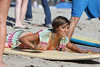Frankie Sandford of The Saturdays takes surfing lessons on Venice Beach Los Angeles, California