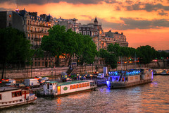Raining Cats and Dogs (chiriacradu) Tags: sunset sky orange paris france seine clouds river bateau hdr solferino
