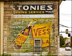 STONIES (FotoEdge) Tags: saved street sign yellow nikon midwest treasure cola bottles buried magic letters cleaning hidden lap missouri weathered roadside siding buriedtreasure 22nd coverup vess d600 fotoedge stonies nikond600 messanie