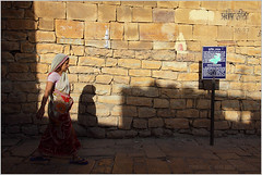 shadows, jaisalmer (nevil zaveri) Tags: street old travel shadow people woman sunlight india streets english heritage tourism monument warning walking photography blog women sandstone photographer shadows notice photos fort walk text stock images billboard photographs photograph language monuments zaveri archeology placard jaisalmer hindi rajasthan archeological stockimages travelogue nevil nevilzaveri