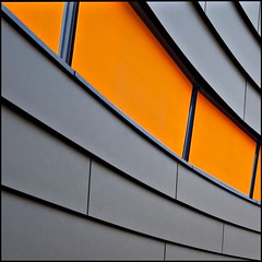 Orangeade (Maerten Prins) Tags: windows urban orange abstract colour building metal wall modern nijmegen grey steel shades curve oosterhout klif