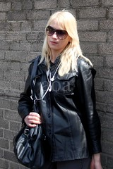 5dMk2K3_6457 (bandashing) Tags: street england music woman black london leather wall manchester ipod random candid jacket blonde earphone handbag e1 sylhet bangladesh bandashing