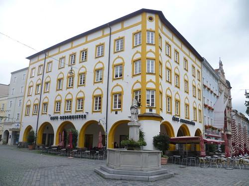 Rosenheim, Bavaria, Germany (Art of Facades of Rosenheim), Max-Josefs-Platz (Café Bergmeister), in the middle of the road the Saint of all bridges of Bavaria John of Nepomuk)