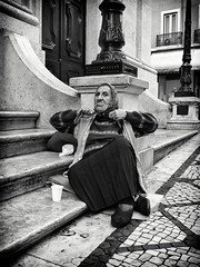Threatening (Fernando_PC) Tags: street woman portugal danger blackwhite flickr downtown close lisbon candid streetphotography beggar baixa seating threaten x10 gettingclose streetphotographer lowpov 500px mrseries fujifilmx10 fernandopc