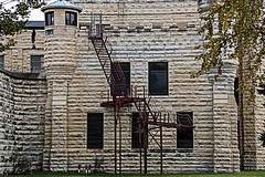 Photographing around Joliet, IL on 10-20-2012 (RickDrew) Tags: rot castle window glass stairs pen lost wire rust bars closed state brothers decay labor bricks hard rusty blues center security chain prison step forgotten jail link limestone fencing exploration barbed cyclone joliet prisoner spiked penitentiary urbex lockedup incarceration correctional inmates crenelations incarcerated
