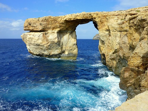 The Azure window. A natural bridge in Dwejra Point of Gozo - Malta.