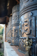 Vishnu visits the great prayer wheels. (TREASURES OF WISDOM) Tags: sculpture statue mystery museum wow wonderful asian religious temple nice fantastic ancient nikon worship shrine vishnu god spirit buddha quality buddhist indian magic prayer buddhism exhibition religon collection prayerwheel figure sacred offering unknown ritual tibetan unusual spirituality wisdom om spiritual hindu artifact healing hinduism paganism brilliant deity shamanic mystic votive pagan artefact unseen namaste asianart mythical shamanism murti tantric ancientworld southindian deitys intresting lordbuddha lordvishnu godofwisdom indianbronze ommanipadmihum hindusaint wisdomfromtheeastwisdomfromthewest indianbronzes mortyhindu