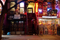 St. Mark's Place at Night - East Village - New York City (Vivienne Gucwa) Tags: nyc newyorkcity eastvillage newyork tattoo night cow nightlights manhattan streetphotography neonlights gothamist lowermanhattan curbed neonsigns urbanphotography citynight nycnight hangingshoes wnyc newyorknight nycphoto nycstreetphotography cityphoto a99 cityphotography sonydslr newyorkphoto nycphotography newyorkstreetphotography newyorkcityphotography manhattannight sonyfullframe viviennegucwa viviennegucwaphotography sonya99 shoesdanglingofftree andromedaeastvillage