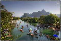 Bamboo Rafts on Yulong River (Frank Kehren) Tags: china canon yangshuo f11 24105 yulongriver canonef24105mmf4lis ef24105mmf4lisusm karsthills bamboorafts canoneos5dmarkii yulongbridge guangxizhuangzuzizhiqu baishatown yulonghescenicarea