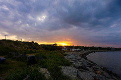 Sunset over Cahore, Wexford (ronamkelly) Tags: rocks pebbles beach harbor harbour water sea ocean sun clouds cloudscape cloud scenic scenery view ireland irish cahore ballygarrett cloudy countryside marine waterscape shore autofocus sony sonyilce5000 sonya5000