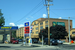 Sunoco, Quality Inn And The Club. (dccradio) Tags: massena ny newyork upstateny northernny stlawrencecounty retail downtown store sky bluesky motel lodging inn hotel qualityinn powerpole utilitypole electricpole sign wires lines electriclines powerlines utilitylines utilitywires powerwires electricwires sunoco gasstation conveniencestore theclub restaurant clouds tree trees
