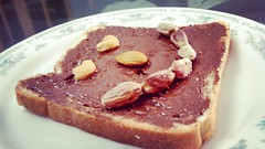 When the bread smiles (mahaadil) Tags: food chocolate lover chocolatelove heaven foodie love bites nutella smile indoor dessert cake pistachio dryfruits almond
