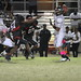 Pharell Jean Baptiste (57) and Shawn Lawrence get pressure on Everglades QB Joshua Cartwright
