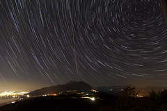 Night flights (ChrisBrn) Tags: mountain night stars lights europe airplanes greece citylights nightsky startrails polaris ioannina cartrails airplanetrails