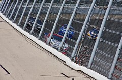 Fenced Them Out (spincast1123) Tags: blue summer people white cars wall race canon fence advertising illinois post pavement racing september vehicles numbers nascar barrier joliet 2012 blacktop chicagolandspeedway sponser 40d canon40d spincast1123 chaseforthechampionship