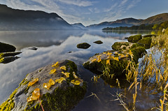 Ullswater in Autumn (John Ormerod) Tags: uk morning autumn trees light england cloud sun mist lake mountains fall nature water grass leaves reflections landscape dawn moss nikon rocks lakedistrict scenic hills cumbria fells autumnal ullswater d7000