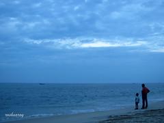 Father, son and the sea... (rO$hN@ rOy) Tags: sea sky sun beach clouds evening father kerala monsoon marari