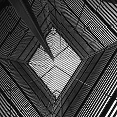 Ever Decreasing Diamonds (Daniel Borg) Tags: uk england sky blackandwhite bw white abstract black reflection london architecture diamonds unitedkingdom wideangle structure symmetry diamond lookingup embankment towerhill bankside morelondon canon1022 canon550d