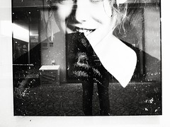 Veiling Reflections (Yves Roy) Tags: street city shadow urban blackandwhite bw black girl shop contrast dark austria blackwhite raw moody 28mm snap fav20 shopwindow hm yr grd fav10 ricohgrd blackwhitephotos grdiii yvesroy yrphotography