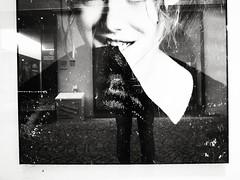 Veiling Reflections (Yves Roy) Tags: street city shadow urban blackandwhite bw black girl shop contrast dark austria blackwhite raw moody 28mm snap fav20 shopwindow hm yr grd fav10 ricohgrd blackwhitephotos grdiii yvesroy yrphotography