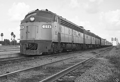 Amtrak Champion is seen at the platform with EMD E-8 locomotive # 214 in the lead, as it perpares to depart on the mainline westbound from the station at Lakeland, Florida, mid 1970's (alcomike43) Tags: old railroad blackandwhite bw classic up station vintage ties photo diesel platform tracks engine trains historic negative amtrak photograph rails depot unionpacific locomotive acl e9 e8 ballast rightofway scl dieselengine 214 mainline seaboardcoastline emd bunit passengertrains roadbed diesellocomotive lakelandflorida dieselelectriclocomotive atlanticcoastline aunit cantileversignalbridge blocksignal amtrakchampion conventionaljointedsectionrail