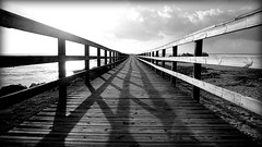 The walk to the unknown (Traveller's soul) Tags: wood sea sky bw portugal pier vanishingpoint wooden shadows path walk unknown vianacastelo week52theme 522012 cln