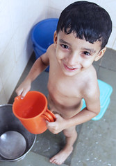IMG_4566 (Charudatta Rane) Tags: india water look happy kid bucket eyes bath mood child innocence smle