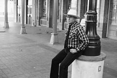 Urban Cowboy (Jesse Acosta) Tags: street blackandwhite man film hat sanantonio cowboy streetphotography tie ilford fp4 yashicaelectro35 125iso 2013 jesseacosta